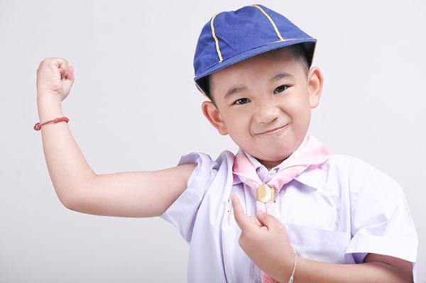 Kid Flexing Bicep